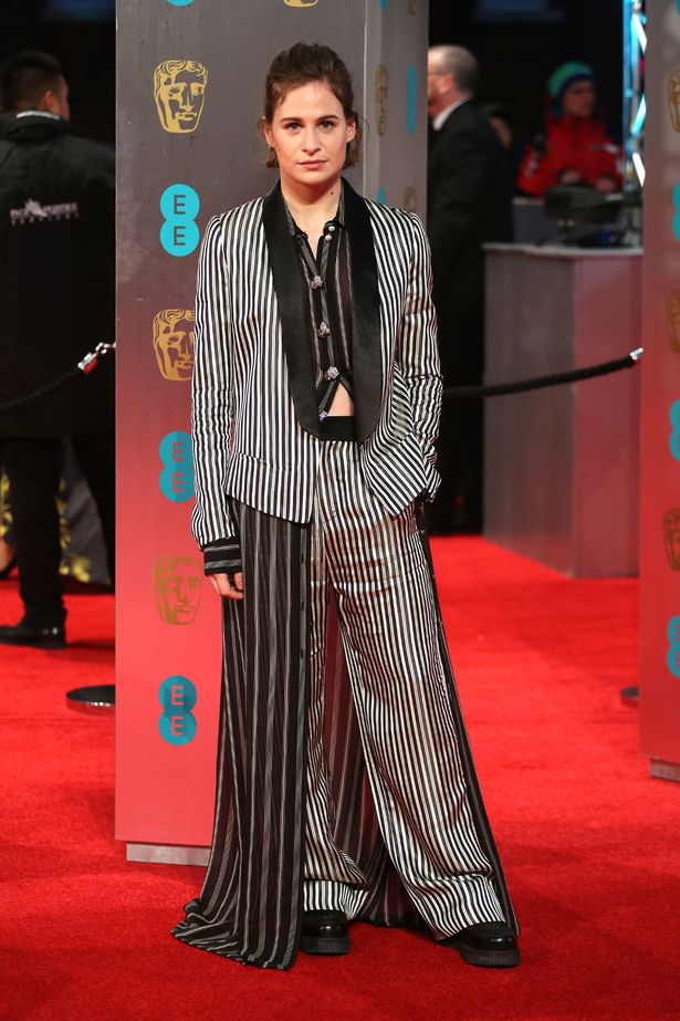 Heloise Letissier (aka Christine and the Queens) in a monochrome suit