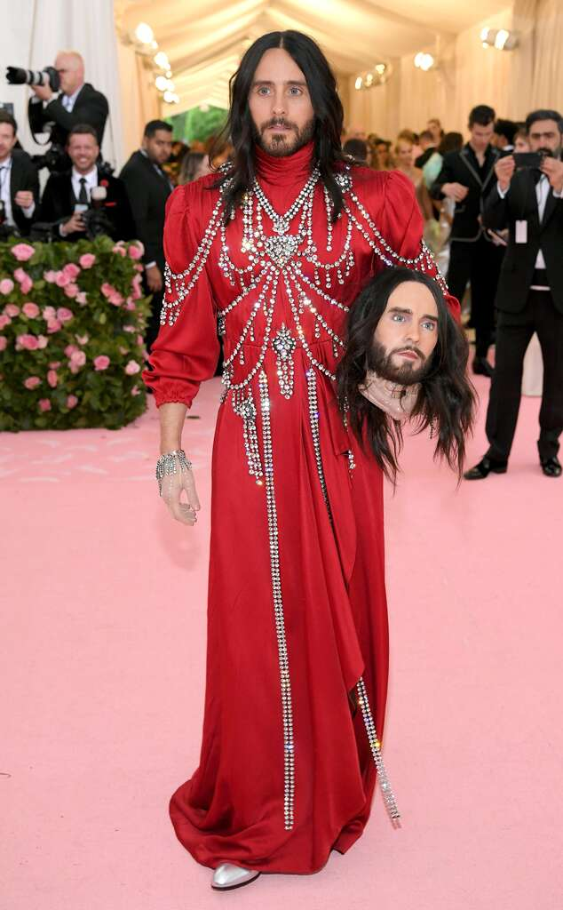 61d7050e44 Not one to avoid controversy, Oscar-winner Jared Leto turned heads in his  scarlet-coloured Gucci outfit and unusual accessory… Carrying a model of  his own ...